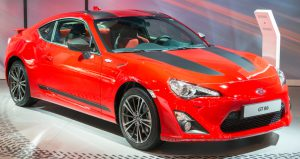 Brussels, Belgium - Januari 12, 2016: Red Toyota GT 86 or just 86 coupe sports car front view. The car is on display during the 2016 Brussels Motor Show. The car is displayed on a motor show stand, with lights reflecting off of the body.